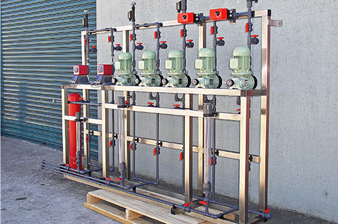 Custom built aluminium dosing skid motorised Iwaki LK metering pumps for water treatment plant.