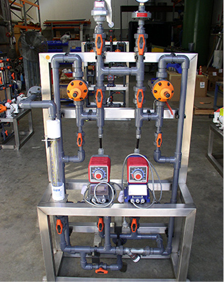 Standardised caustic dosing SKID with Iwaki EH-E solenoid dosing pumps for water treatment plant.